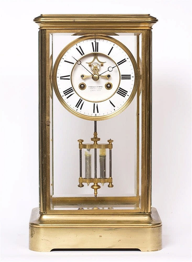 A GIANT 19TH CENTURY FRENCH BRASS FOUR GLASS CLOCK the two piece white enam