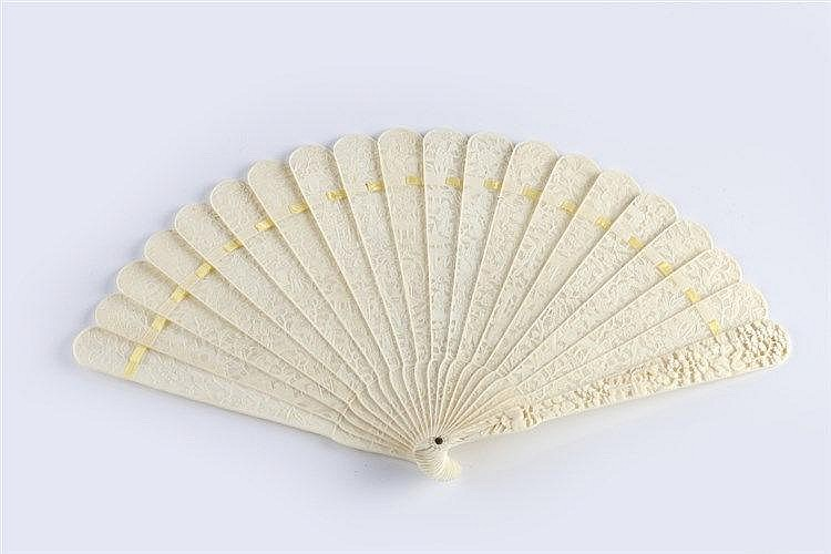 A Chinese Canton ivory filigree fan circa 1880 intricately carved