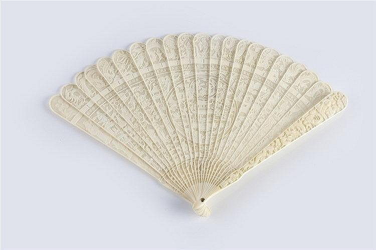 A Chinese ivory Canton filigree fan carved with allover figures and ga