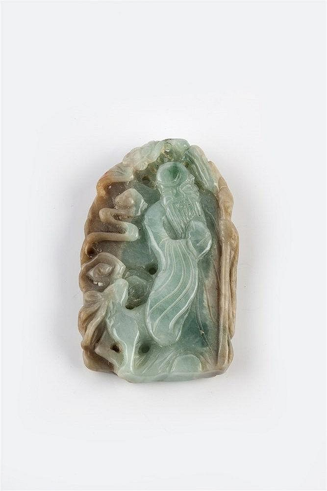 A Chinese green and grey jade pendant 19th Century carved as a figure