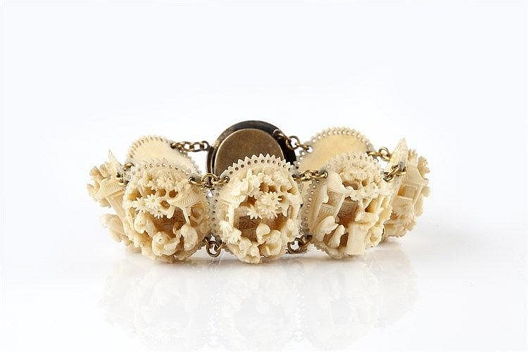A Chinese carved ivory bracelet circa 1900 the oval panels with i