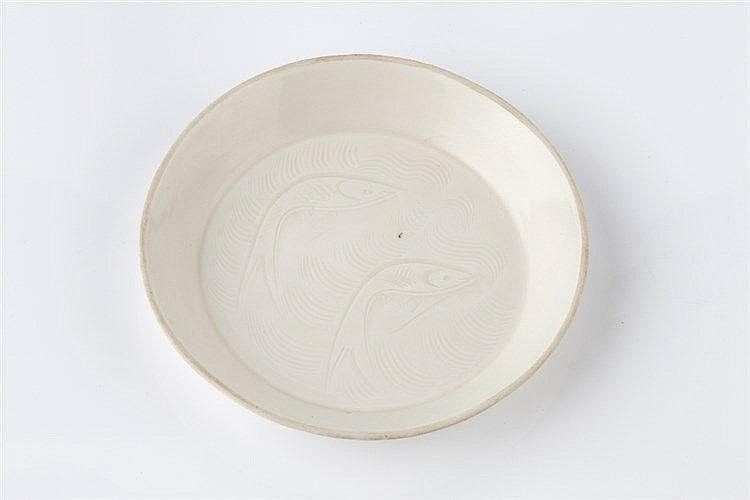 A Chinese ding shallow dish 18th Century decorated with two fish, 12cm