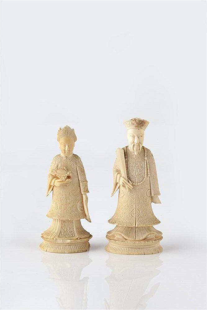 A Chinese carved ivory Emperor and Empress 19th Century Canton, 9cm an