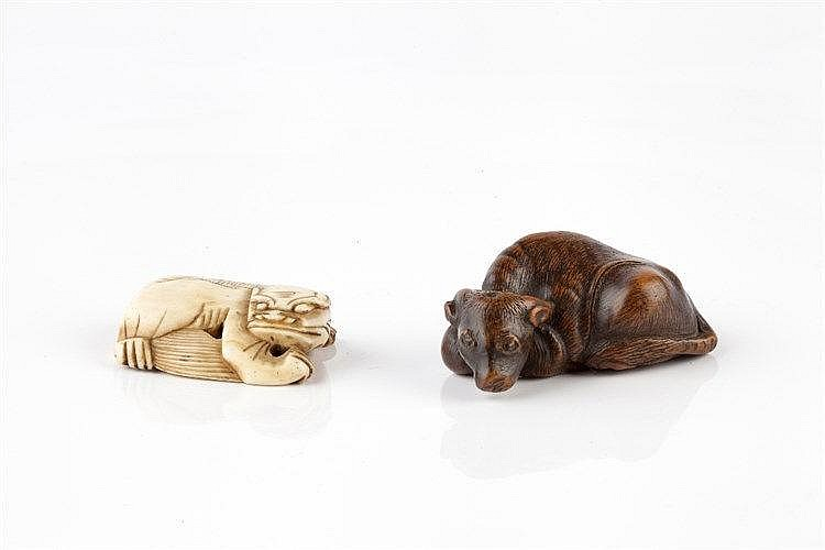 A Chinese ivory toggle late Ming carved as a reclining kylin, 4cm