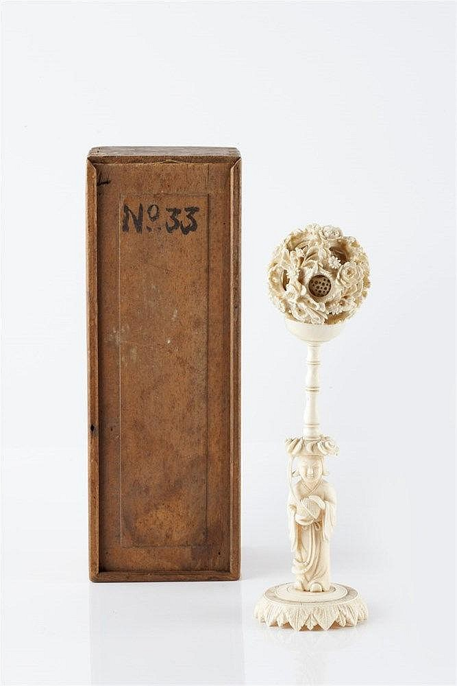 A Chinese ivory puzzle ball on stand circa 1920 the column suppor