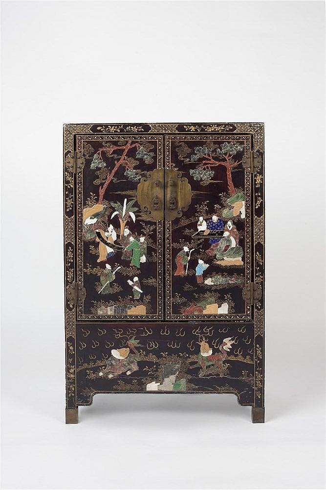 A Chinese black lacquer low cabinet circa 1930 the doors set with