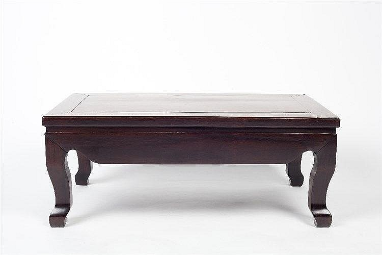 A Chinese hardwood kang table 19th Century of plain form, 44cm x 80cm