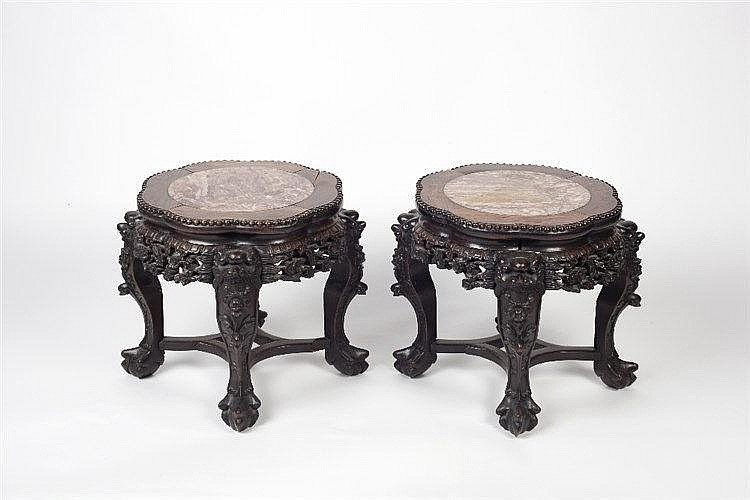 A pair of Chinese rosewood urn stands 19th Century each with inset mar