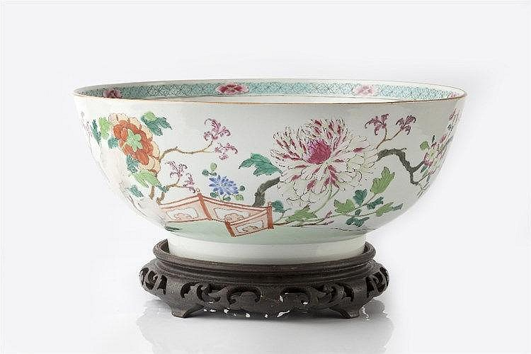 A Chinese famille rose punch bowl 18th Century decorated in polychrome