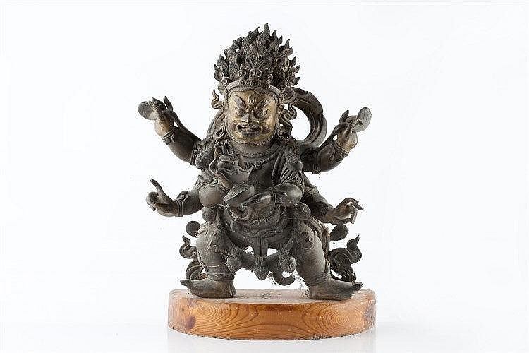 A Sino-Tibetan bronze figure of Mahakala 18th Century clutching a vajr