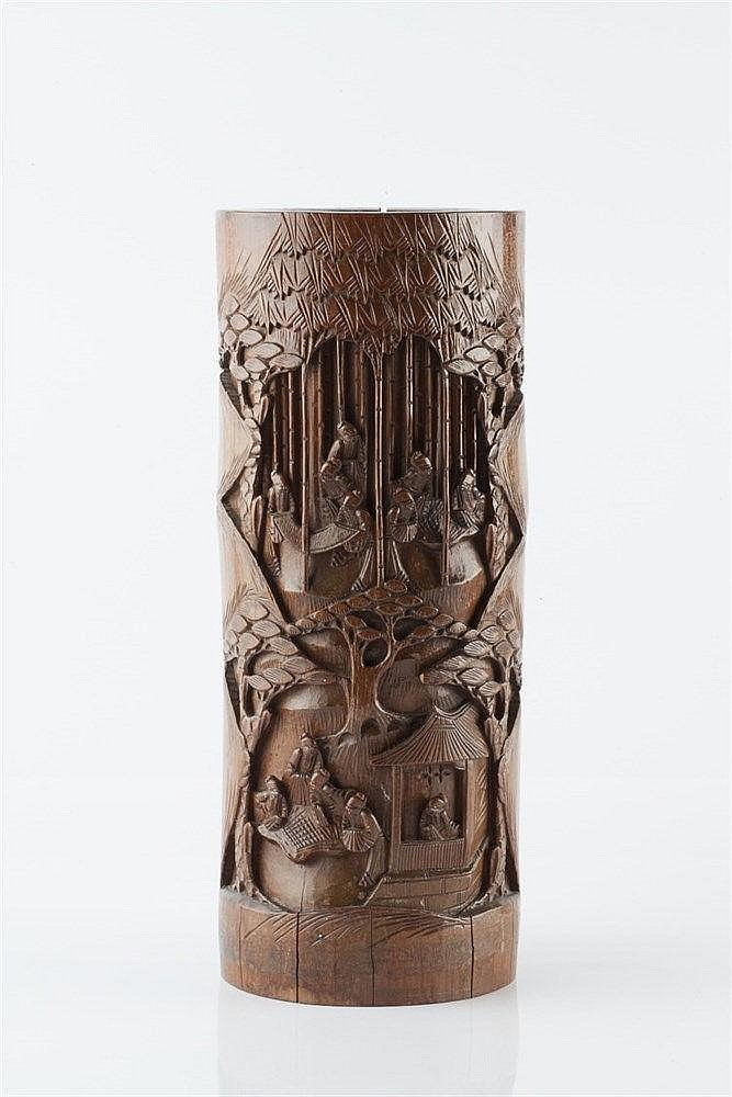 A Chinese tall bamboo brush pot circa 1900 carved with various fi