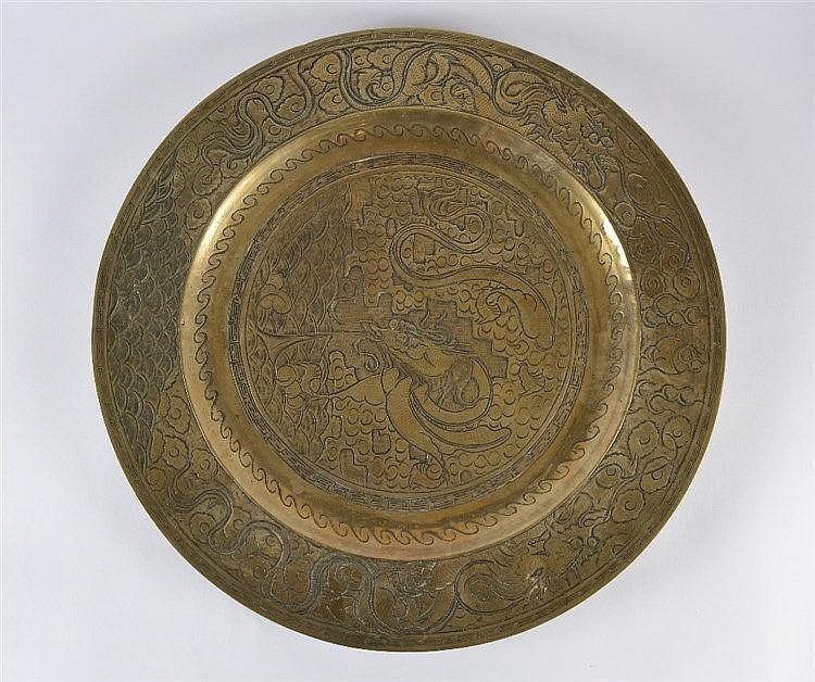 A large Chinese brass charger 19th Century with central dragon, cloud