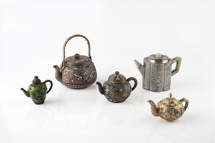 Four Chinese enamel teapots 19th/20th Century and a Chinese Paktong he