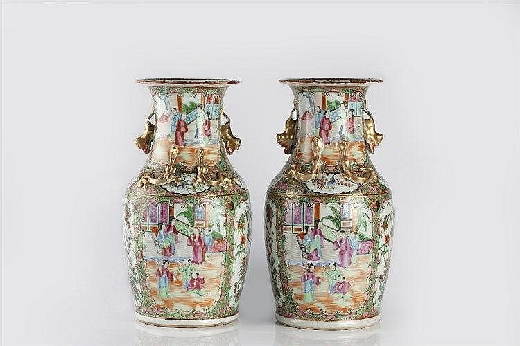 A pair of Chinese Canton vases circa 1880 each with panels of fig