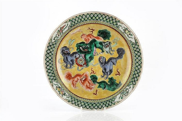 A Chinese Canton dish 19th Century decorated in verte and jaune enamel