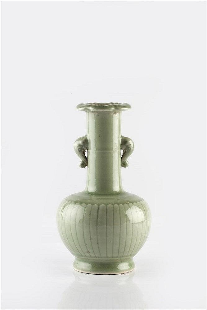 A Chinese celadon bottle vase 20th Century the globular body moulded w