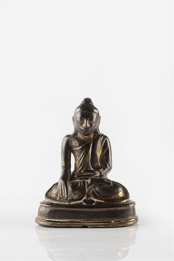 A Burmese bronze Buddha 18th Century the gilt seated figure on a plain