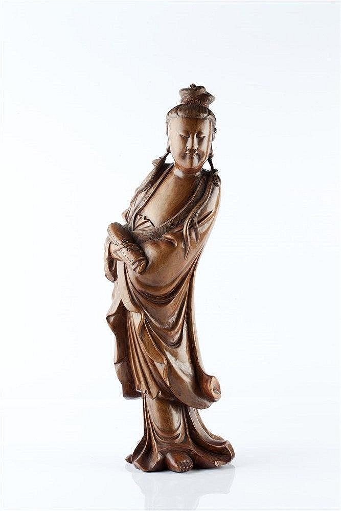 A Chinese carved wood model of Guanyin circa 1900 the standing fi