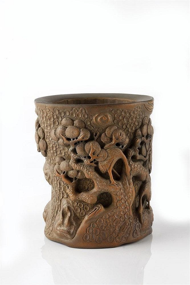 A Chinese bamboo brush pot (bidong) 19th Century carved in high and lo