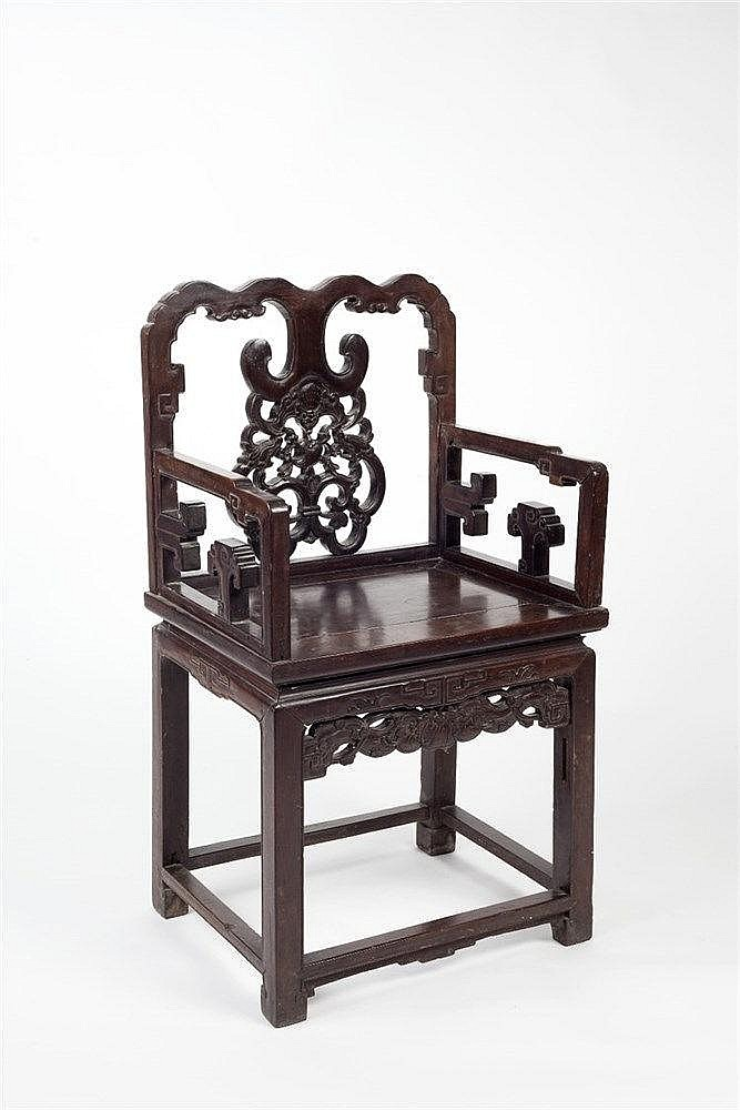 A Chinese black wood altar chair 19th Century  with carved panel back
