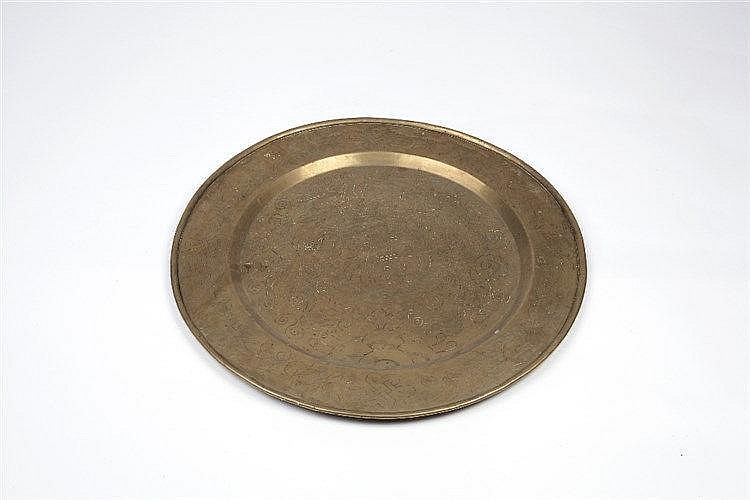 A Chinese brass engraved circular tray late 19th Century with cen