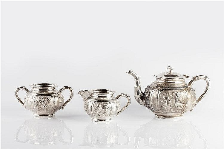 A Chinese three piece silver tea service circa 1900 decorated wit