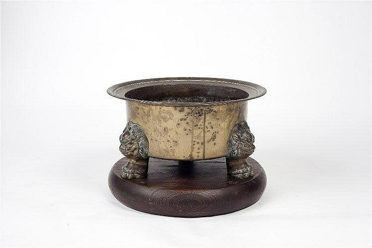 A large Chinese bronze fish bowl 19th Century  on three mask supports,