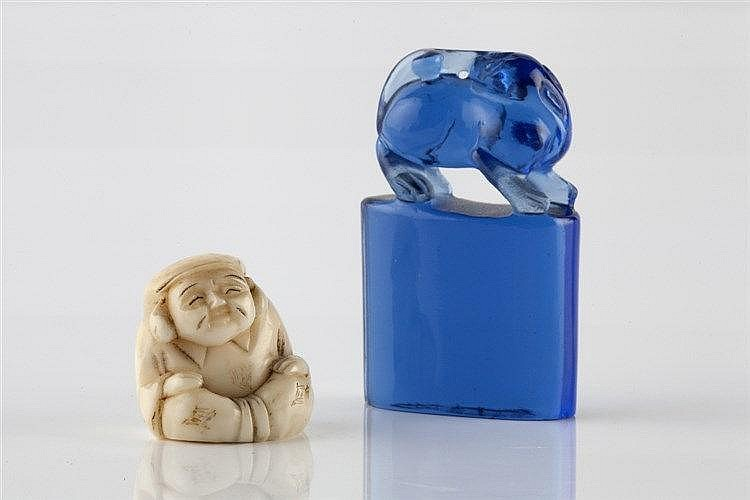 A Chinese blue Peking glass seal 19th Century 5cm and a Japanese netsuke in