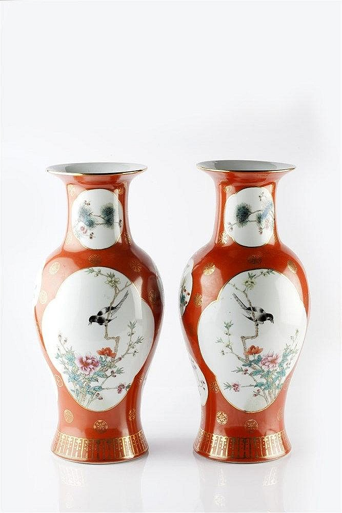 A pair of Chinese coral ground baluster vases and covers 20th Century