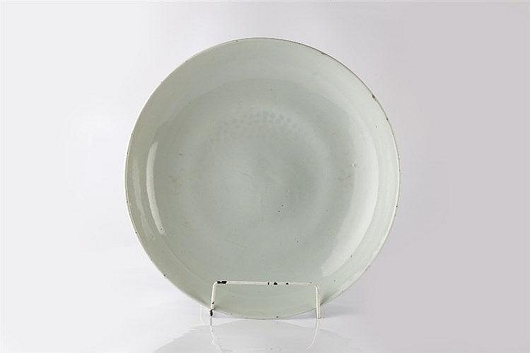 A Chinese white glazed charger early 19th Century of plain form,