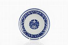 A Chinese blue and white saucer dish 19th Century decorated with an ar