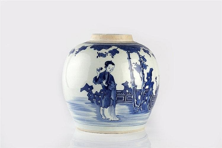 A Chinese porcelain blue and white ovoid jar 19th Century a child hold