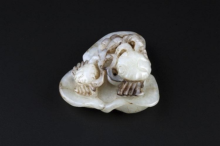 A Chinese white and black jade pebble 17th/18th Century carved as two