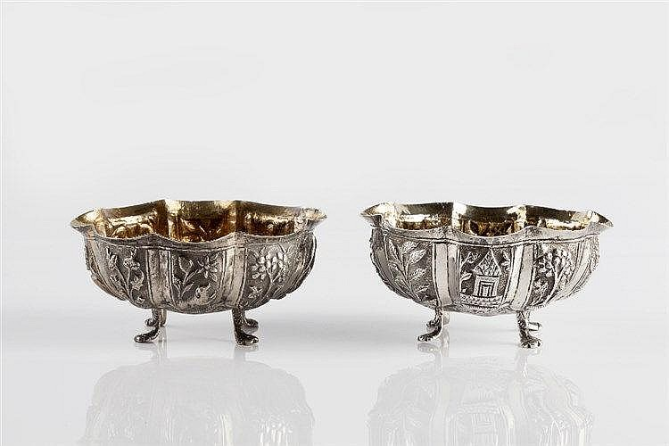 A pair of Burmese silver oval salts late 19th Century with gilt i