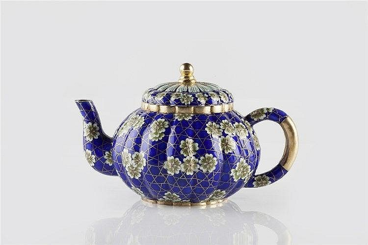A Chinese silver gilt and enamel teapot circa 1900 of blue ground