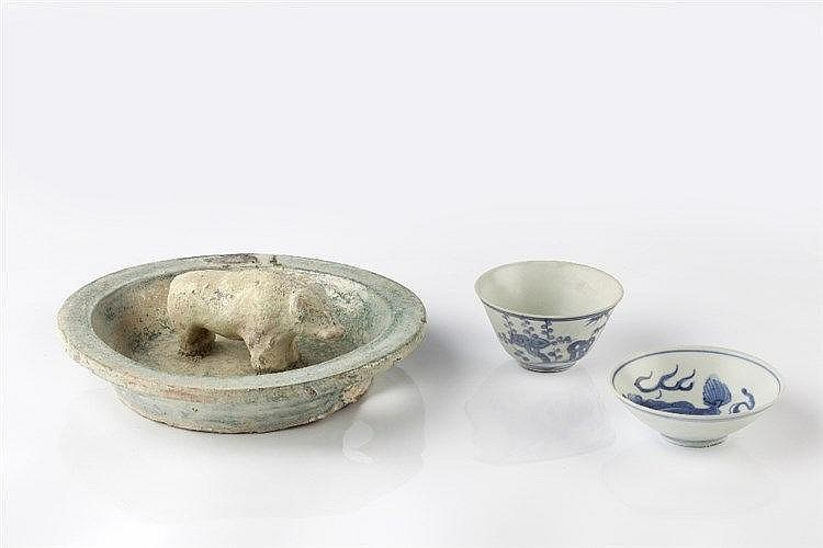 A Chinese bowl probably Han dynasty with central mounted buffalo,