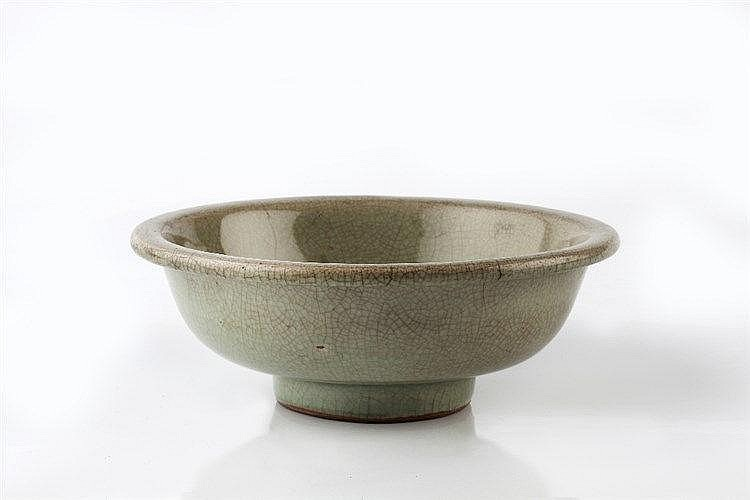A Chinese celadon bowl Song/Yuan dynasty of plain form with crack