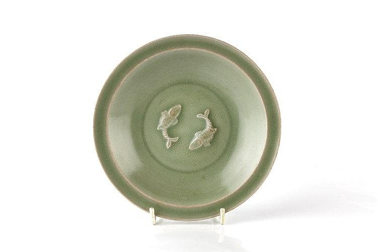 A celadon shallow dish Song dynasty the interior centrally modell