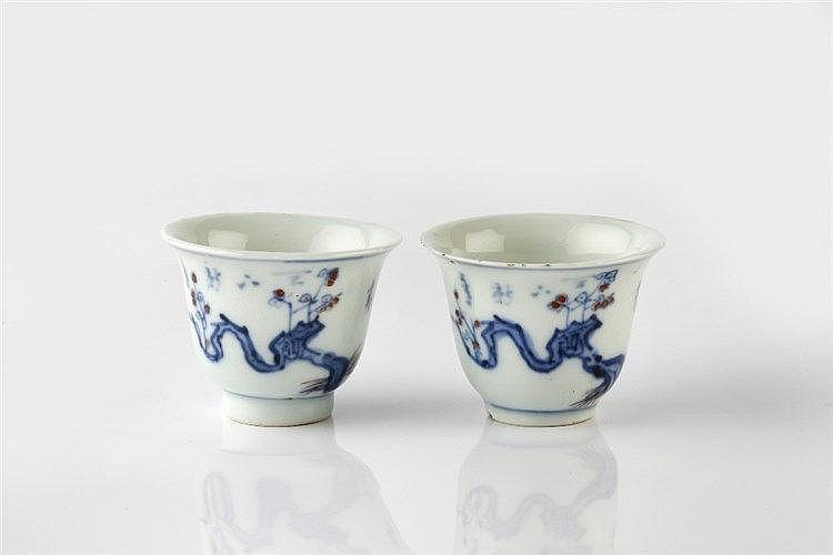 A pair of Doucai miniature wine cups 19th Century decorated flowering