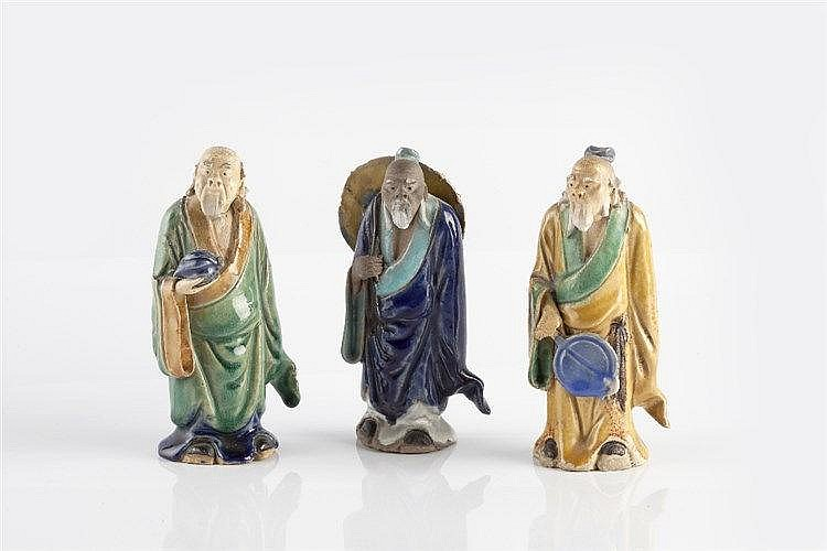 Three Chinese glazed pottery models of Immortals 20th Century largest