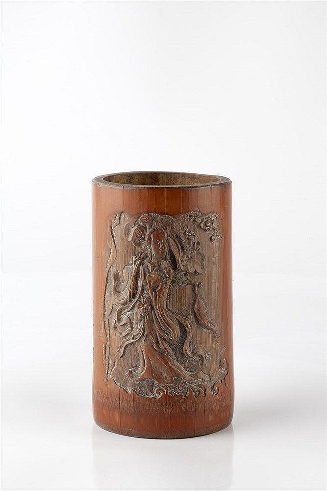 A Chinese bamboo brush pot (bidong) signed and carved in low relief wi