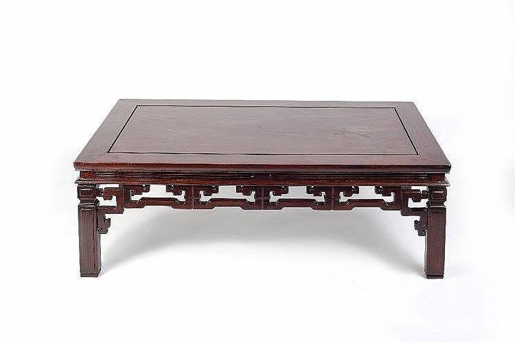 A Chinese hardwood large opium table  early 20th Century having a