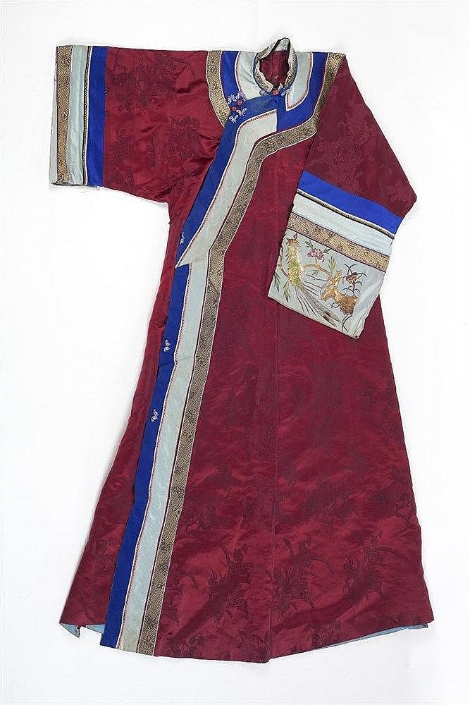 A Chinese burgundy silk coat late 19th Century with turquoise and