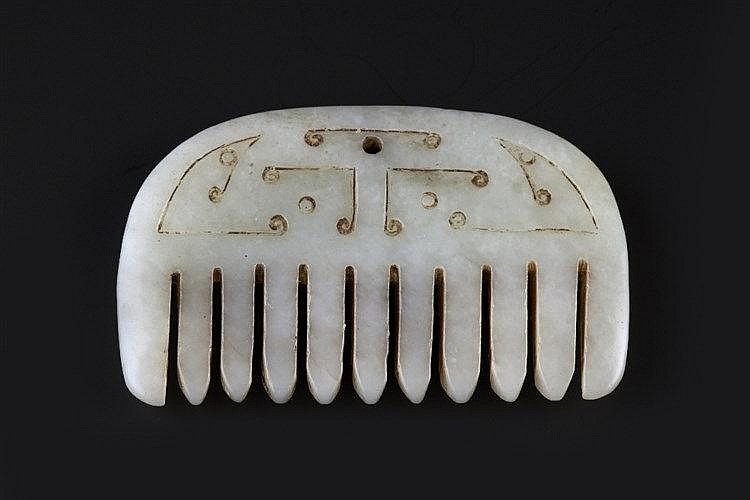 A Chinese Western Han style white jade pendant probably Ming 17th Cent