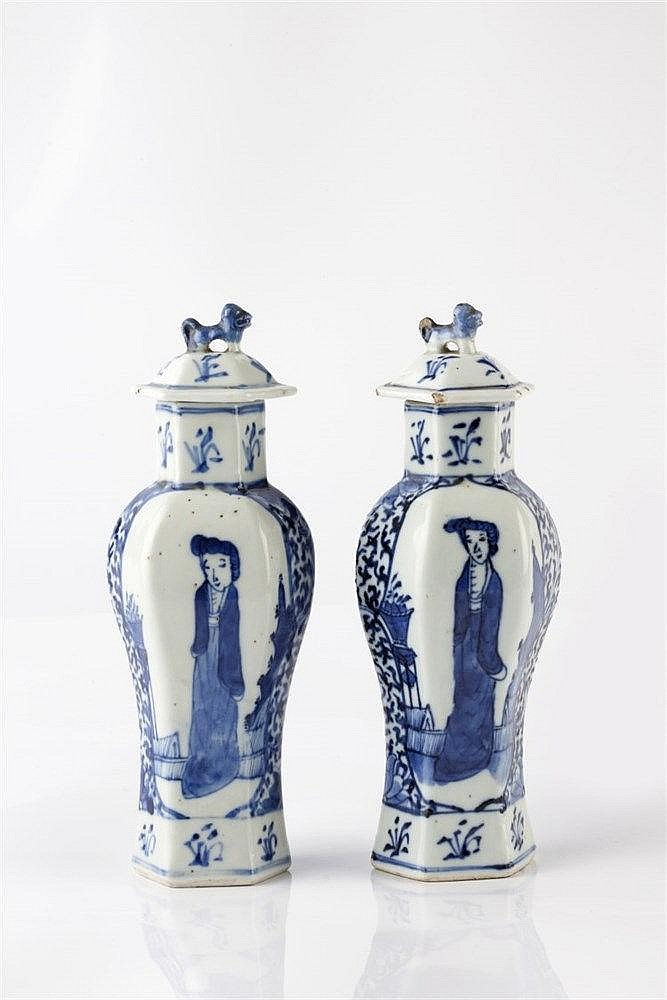 A pair of Chinese hexagonal baluster vases 19th Century decorated with