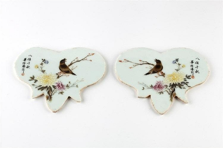 A pair of Republican porcelain pomegranate shaped tiles signed, decora