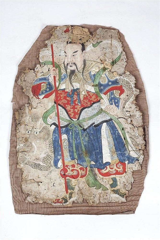 A Chinese fabric fragment 17th Century depicting a warrior holding a s