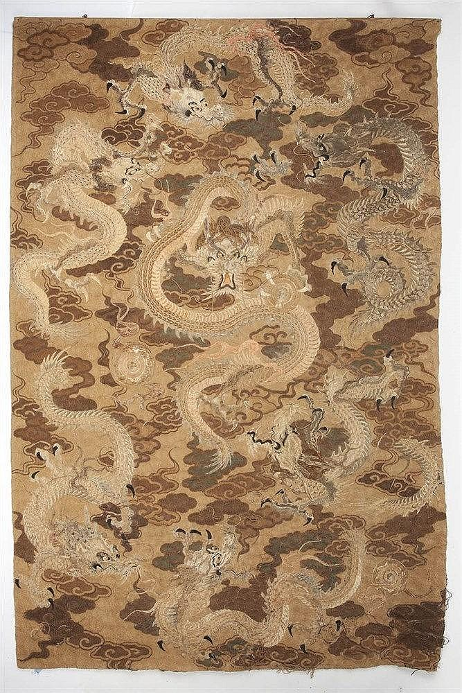 A Chinese wall hanging 19th Century depicting a central dragon in gol