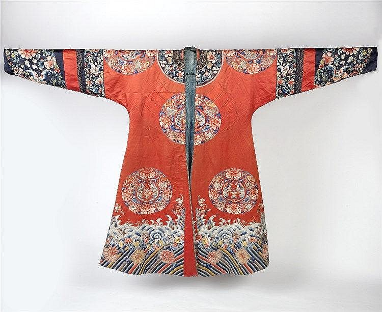 A Chinese robe 19th Century of red ground. decorated with eight rounde