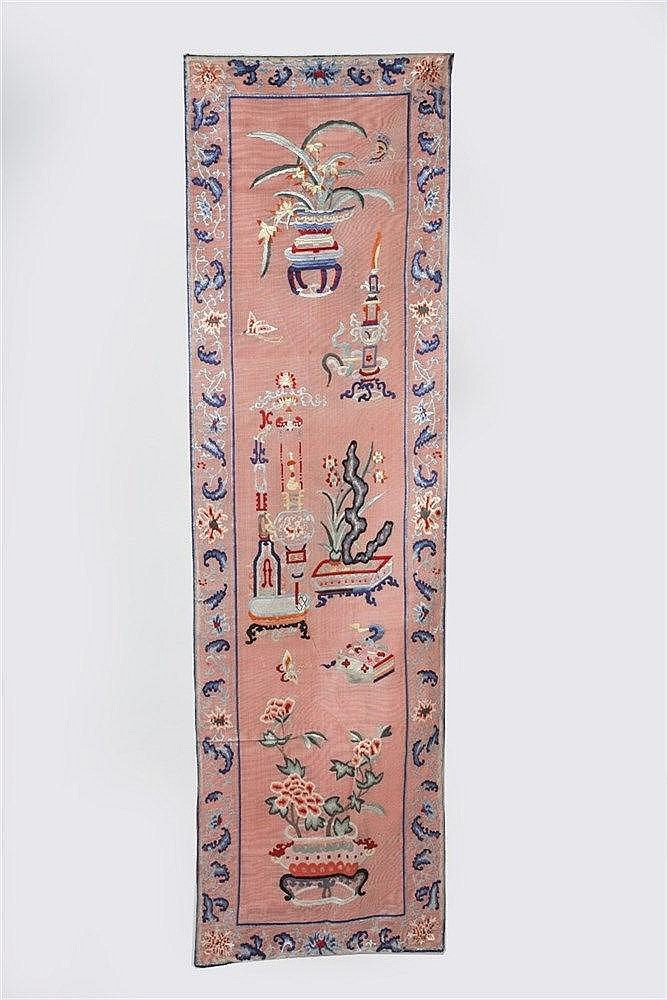 A Chinese long panel  late 19th Century of pink ground form decor